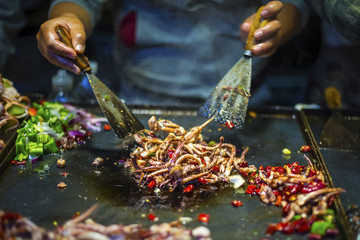 Chinese Chef making Iron Squid. Located in old town of Lijiang, Yunnan Province, China.