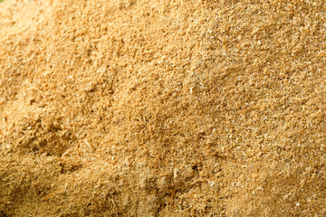 Sawdust stack,Wood Sawdust Texture Background,Wooden sawdust after the production of wood on a sawmill