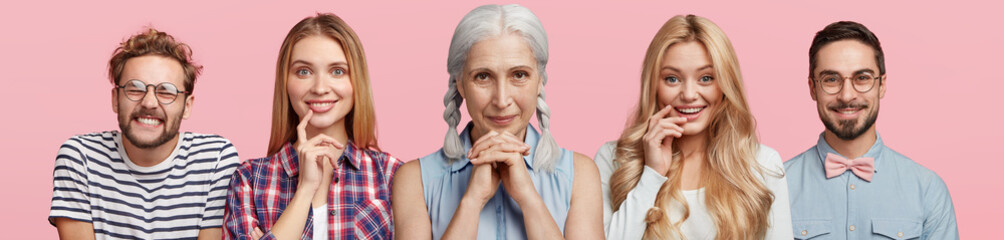Horizontal shot of five people have different age and interests, express various emotions and facial expressions, isolated over pink background. Grey haired woman, two blonde females and bearded men