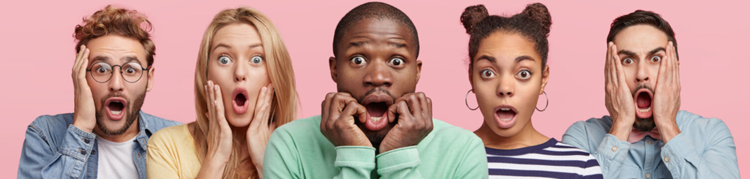 Shocked stupefied dark skinned man and their companions pose against pink background. Emotional surprised horrified mixed race people see something unexpected in front. Human reaction concept