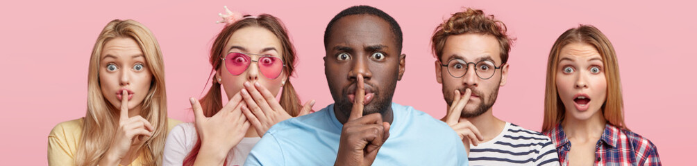 Horizontal shot of five different people show hush sign, look with stupefied expression, demand complete silence, isolated over pink background. Composition of mixed race people with one interest