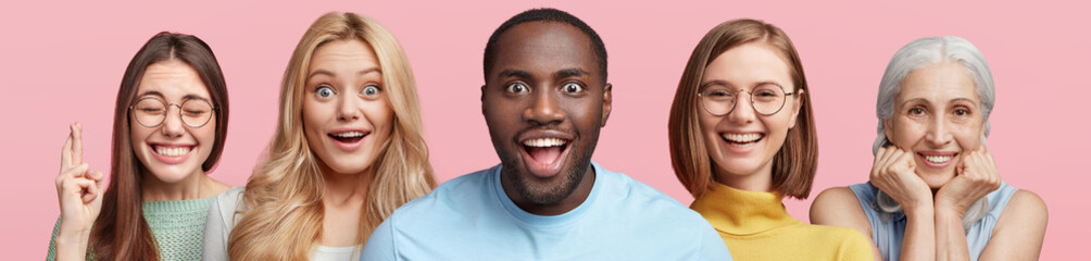 Five mixed race people express amazement and positive emotions. Black dark skinned male in centre with excited look. Brunette female crosses finger before exam. Elderly female smiles happily