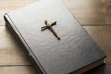 Wooden Christian cross on the Bible