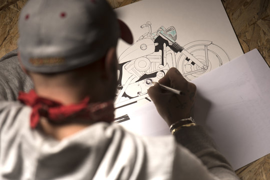 Motorbike designer drawing a custom model