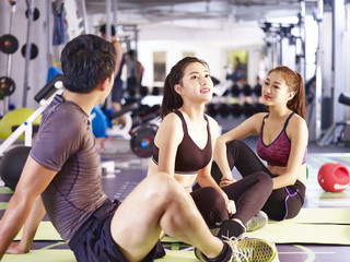 asian young man and women resting during exercise
