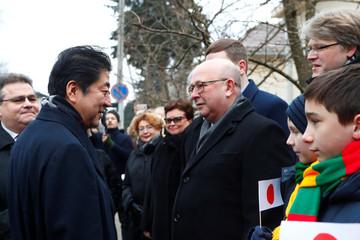 Mayor of Kaunas Visvaldas Matijosaitis welcomes Japan's Prime Minister Shinzo Abe as he arrives to visit former home of Chiune Sugihara, a Jew-saving Japanese diplomat in Kaunas