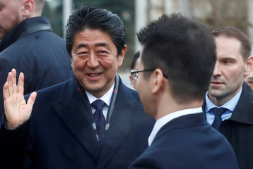 Japan's Prime Minister Shinzo Abe reacts after visiting a former home of Chiune Sugihara, a Jew-saving Japanese diplomat in Kaunas