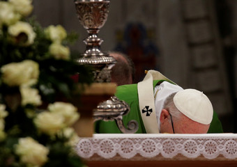 Pope Francis kisses the main altar as he leads a special mass to mark International Migrants Day in Saint Peter's Basilica at the Vatican