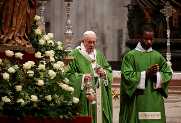 Pope Francis leads a special mass to mark International Migrants Day in Saint Peter's Basilica at the Vatican