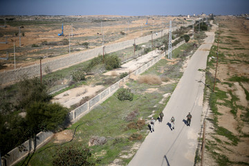 Palestinian security forces loyal to Hamas patrol near the border between Egypt and Gaza, in the southern Gaza Strip