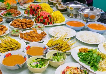 Food Variety Table top Fried chicken Fried fish roasted pork papaya salad roasted duck and fruit Orange watermelon