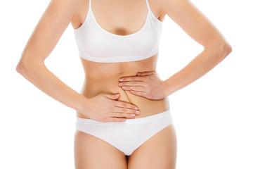 Woman massaging stomach pain