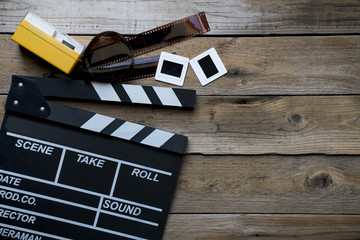 movie clapper on wood table ; film, cinema and vedio photography concept