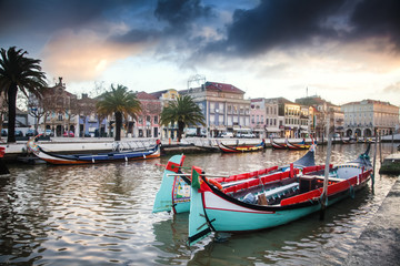 Beautiful cityscape. Bright boats on the pier in Aveiro, Portugal, at sunset