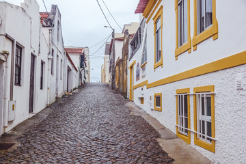 Beautiful cityscape. Cobbled street in the center of Nova Costa, Portugal