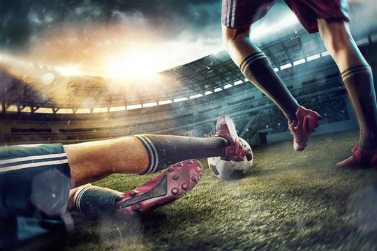 The soccer football players at the stadium in motion