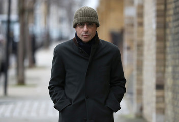 French businessman Alexandre Djouhri arrives to report to Notting Hill Police Station, in London