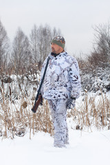 hunter with shotgun on winter hunting