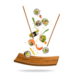 Flying sushi pieces on white background