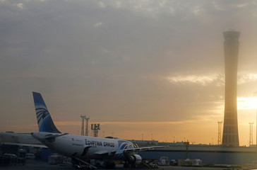 Egyptair Airlines plane is pictured through the window of an airplane of Etihad Airways after landed on the runway at Cairo International Airport