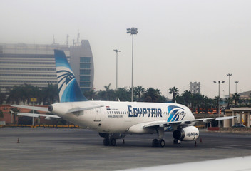 Egyptair Airlines A320  plane is pictured through the window of an airplane of Etihad Airways after landed on the runway at Cairo International Airport