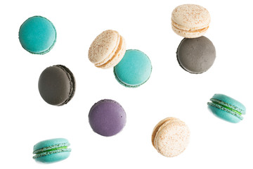 Foto op Textielframe Macarons flying Colorful macarons on white background. Minimal pattern, creative dessert concept