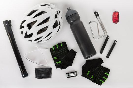 Bike accessories, bike helmet, bike gloves, eyeglasses and water bottle in holder