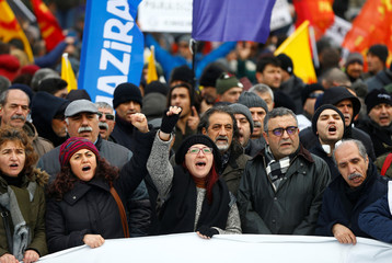 Demonstrators shout slogans during a protest against the government's plan to extend the state of emergency imposed after the 2016 coup attempt for another three months, in Istanbul