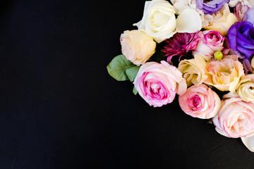 beautiful flowers assortment on dark background. free space concept. floristic art