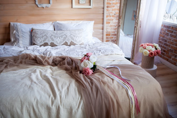 The bedroom is in the style of Provence wooden wall decorated with photo frames bed linen