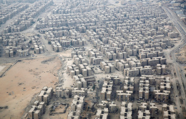 An aerial view of new housing complexes in a suburb of Cairo is pictured through the window of a plane, Egypt