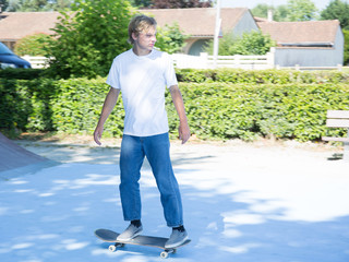 skater boy riding on mini ramp in summer day Skateboarder on skate board. Skateboarding contest Extreme sports for young and active teenager