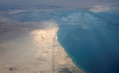 An aerial view of the coast of the Red Sea is pictured through the window of an airplane near Sharm el-Sheikh, Egypt