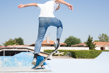 Boy Skateboarding Jump Lifestyle Hipster Concept rear view