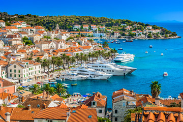 Hvar town mediterranean landscape. / Aerial view at Hvar town in Southern Croatia, famous luxury travel destination in Europe, Mediterranean. Wall mural