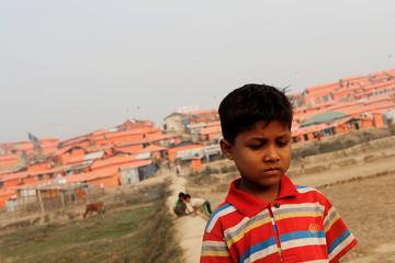 A Rohingya refugee boy reacts as he walks at Palong Khali camp, near Cox's Bazar