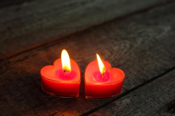 Heart shaped candles burning