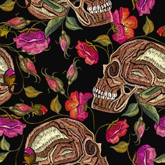 Embroidery skull and flowers seamless pattern. Fashion template for clothes, textiles, t-shirt design. Gothic romantic embroidery human skulls red roses and peonies pattern