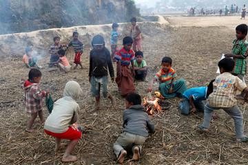 Rohingya refugee children burn straws for fun at Palong Khali camp, near Cox's Bazar