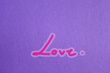 Handwritten '' LOVE '' On purple paper ,Style beautifully simple.