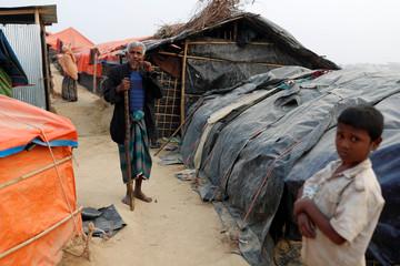 An elderly Rohingya refugee walks inside the Palong Khali camp, near Cox's Bazar
