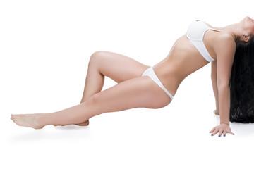 Woman in underwear on white, cellulite on female body