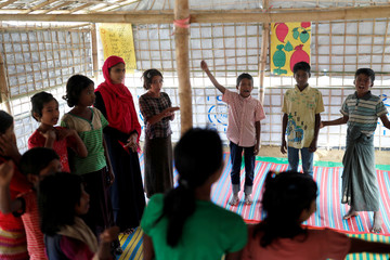 Rohingya refugee children attend a lesson in Palong Khali camp, near Cox's Bazar