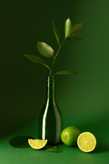 Fresh limes on green background