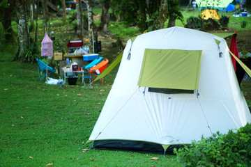 nature landscape camping tent with decor accessory on meadow national park and green grass with tree in jungle for holiday relax trip on winter