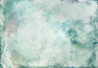 Grunge abstract background of watercolor paint blurred green color on paper with texture, in middle of an empty space for text.