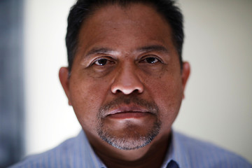 William Lopez, who was deported from the U.S. a year ago, poses for a picture in San Salvador