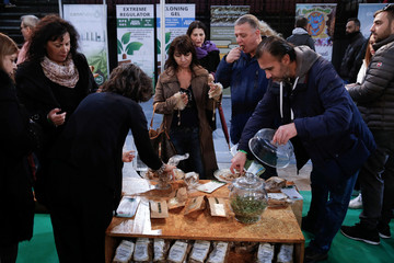 Visitors taste cannabis-based products during the 1st International Cannabis Expo, in Athens