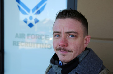 Nicholas Bade, 37, poses outside a recruitment center in Chicago