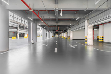 interior of parking garage with car and vacant parking lot in parking building